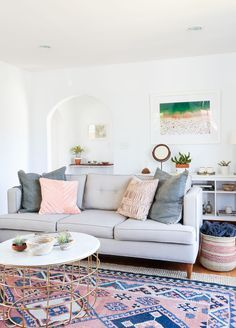 Perfect combination of classic and modern with the bohemian rug and minimalist pastel sofa. #love #interior