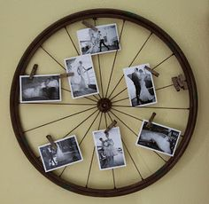 What a great idea from Montana Bride - a spoke wheel and some clothes pins as a photo display.