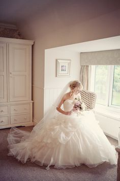 Wow. What a wedding dress! Fit for a Fairytale princess. Love this shot by Katy Lunsford Photography
