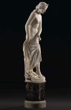 Giovanni Battista Lombardi 1823-1880 ITALIAN NAJADE O NINFA (NAIAD OR NYMPH) white marble, on a veined red marble and white marble base figure: 141cm., 55 1/8 in. base: 49 by 40 by 40cm., 19¼ by 15¾ by 15¾in.