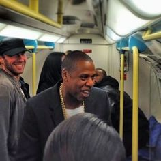 Jay Z and Chris Martin on the Tube.