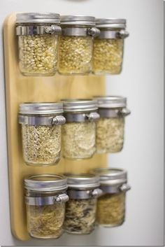 This has been the handiest little thing ever. I store dinner-sized servings of rice, quinoa and even popcorn in these mason jars and hang them using pipe clamps that are screwed into a sturdy piece of wood. It gets all those boxes off my shelf and looks pretty,too! Best pantry organization idea I've seen all day.