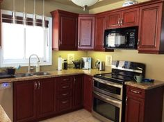 Kitchen With Cherry Cabinets Double Oven Stove And Granite Countertop Cocinas Pinterest