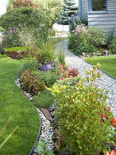 Use Interesting Edging.  Edging gives your garden a crisp, clean look. But be creative and add interest by making your edging a design element. Here, the wide swath of rock between the lawn and the plantings gives the feel of a flowing river.