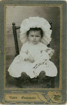 Wonderful antique photo of unhappy little girl with her doll, circa 1860 - 1880.