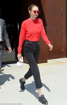 Red hot: Gigi Hadid was spotted dressed casual cool while leaving her apartment in New York City on Wednesday morning