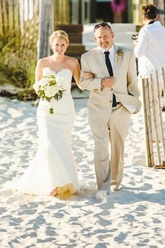 Beautiful beach wedding // Christopher Nolan Photography - christophernolanphotography.com // Read More: http://www.stylemepretty.com/2013/12/27/halekai-iii-house-wedding/