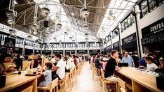 The recently renovated Mercado da Ribeira in Lisbon, established in 1892, features traditional elements and contemporary cuisine.