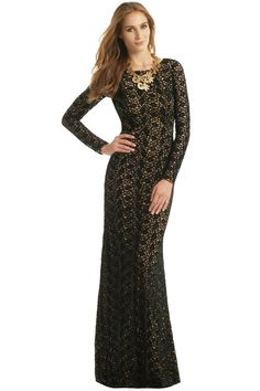 Black Lace with Nude Underlay (100% Polyester). Long sleeves. Crew neckline. Fitted skirt. Hidden back zipper with hook-and-eye closure. Lined. See size and fit tab for lengths. Imported.