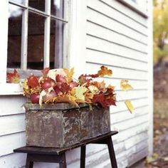 Use rectangular platners on benches or painted sawhorses as makeshift windowboxes! Fill with autumn foliage, gourds, etc. | 18 easy autumn decorations | Living the Country Life | http://www.livingthecountrylife.com/fall-decor/