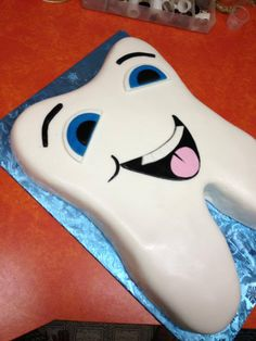 Smiling tooth cake