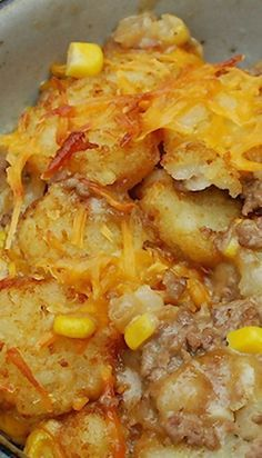 Cowboy Casserole Recipe ~ A delicious mix of hamburger, cheese and corn sandwiched in between a layer of crunchy tots. I used hash browns for bottom layer and tater tots for top layer, and I added crumbled bacon to mixture--YUMMY! Great Recipes, Dog Food Recipes, Dinner Recipes, Cooking Recipes, Favorite Recipes, Hamburger Recipes, Comfort Food Recipes, Hamburger Hotdish, Hamburger Steaks