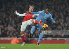Nacho Monreal of Arsenal challenges Julien Ngoy of Stoke during the Premier League match between Arsenal and Stoke City at Emirates Stadium on December 10, 2016 in London, England.  (Photo by David Price/Arsenal FC via Getty Images)