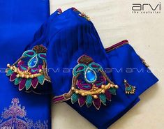 Gorgeous deep blue and powder blue color combination designer blouse with hand embroidery work. Cutwork Blouse Designs, Simple Blouse Designs, Stylish Blouse Design, Bridal Blouse Designs, Blouse Neck Designs, Sleeve Designs, Hand Embroidery Design Patterns, Designer Blouse Patterns, Hand Work Blouse Design