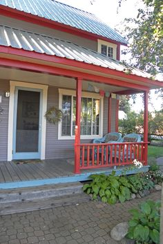 eclectic porch with grey exterior walls red railing system single front door with blue and white trims exterior glass window with white frames lightweight aluminum roofs of 50 Inspiring Photos of Home Railing Front Ideas