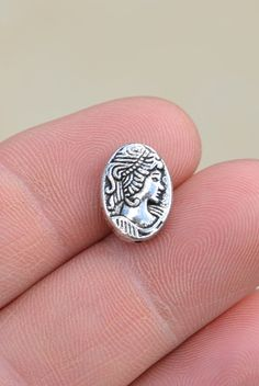 Antique Silver Tone Womans Face Beads.  13 x 9mm Beads 5 Beads per package  SHIPPING: I do combine shipping at a flat rate in the United States,