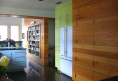 white oak tongue & groove walls, yellow pantry cabinet with white KitchenAid refrigerator