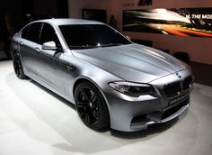 2014 BMW M5 in Matte Silver. Black rims and grille sets it off!! Extremely powerful car
