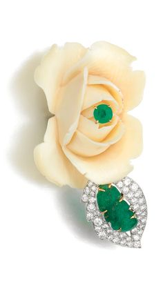IVORY, EMERALD AND DIAMOND BROOCH, CARTIER, 1950S Designed as a carved ivory rose, set with a circular-cut and carved emerald and brilliant-cut diamonds, signed Cartier, numbered, French assay and maker's marks, fitted case stamped Cartier.