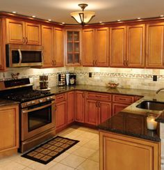 This could be it, but can I use the dark counters with light backsplash and black appliances.