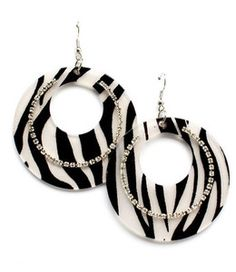 This is a pair of large round shape zebra print earrings. Made with acrylic and adorned with sparkling rhinestones.
