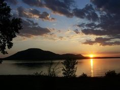 Explore the 21 miles of shoreline of Lake Lawtonka in Lawton at dusk for a beautiful view of a sunset like this one.
