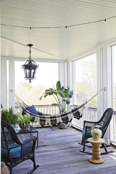 A hammock Lynne picked up in New York strikes a decidedly Bohemian note that's balanced by the traditional silhouette of the iron light fixture.