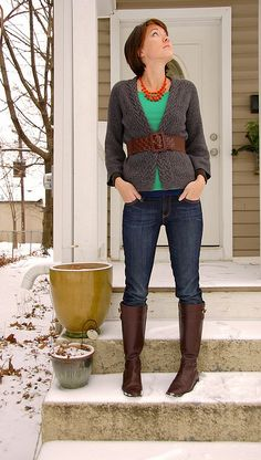 skinny jeans, brown boots, green top, grey cardigan with thick belt, statement necklace