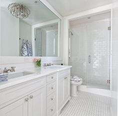 White bathroom design using white glass 3x6 subway tile in the shower. https://www.subwaytileoutlet.com/products/White-Glass-Subway-Tile.html#.VN0rovnF-1U