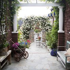 This is my dream patio for my back yard. It has everything I love: weathered planters and benches, and a quaint bistro set. Nothing overly manicured or rigid. Very natural and cozy. Thanks for stopping by!