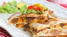 Cheeseburger fixings piled between two layers of buttery tortillas. Yes, this Mexi-Cheeseburger Quesadilla just happened.