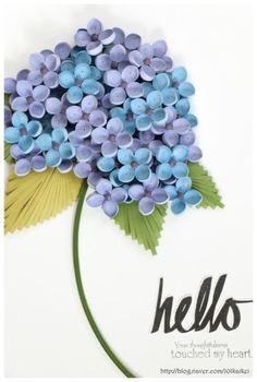 종이감기로 만든 수국입니다. 사이즈 23*31꽃을 50송이 만들어 겹쳐 붙였어요.꽃 만드는데 3mm띠지를 400개...