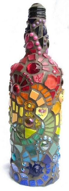 Wine bottle mosaic-- Could do this with that cement stone kit they have at Wal-Mart! OMG!