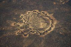 Remains of an ancient trap or desert kite between As Safawi and Qasr Burqu, Mafraq, Jordan - Yann Arthus Bertrand
