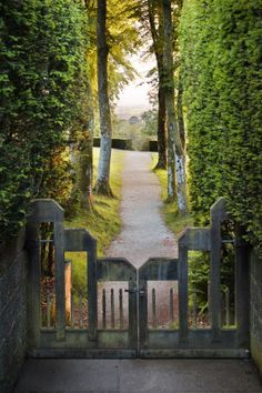 Gateway and path from the garden entrance at Castle Drogo, near Exeter, Devon, looking out towards Dartmoor. Castle Drogo is a National Trust property.