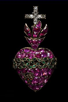 Silver and gold ruby heart weeping diamond tears, encircled by an emerald crown of thorns surmounted by ruby flames and a diamond cross Portuguese, c. 1780... By Artist Unknown...