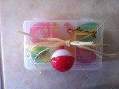 Great for kids at the party for favor :)) got small fish tackle box's from Walmart for $1 and put gummy worms in them as bait! And  tied a small bobber to it!