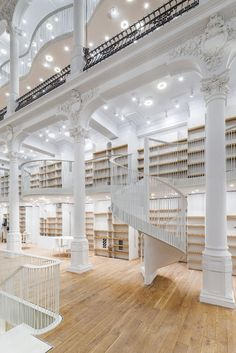 A Breathtaking All-White Bookstore Opens in a 19th Century Building in Bucharest, Romania