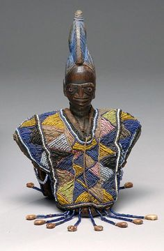 Africa | Twin memorial figure ~ ere Ibéjì ~ wearing a beaded garment ~ èwù ìlè kè ~ from the Yoruba people of Nigeria | Wood, glass beads, cowrie shells, fabric and leather | ca. 19th - 20th century
