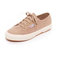 2750 wool sneakers by Superga. Casual Superga sneakers in soft felt. Tonal ties lace through logo embossed grommets. Rubber sidewall and crepe sole....