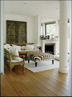 want a big ottoman instead of coffee table- thinking as my touch of animal in the room- zebra!