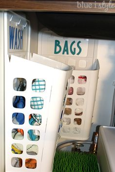 This is a brilliant use of platic trash baskets from Ikea! Perfect for under sink organization! Create a laundry basket for dirty dish towels and keep your plastic shopping bags from taking over the cabinet under your kitchen sink!
