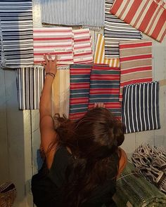 Our Shiomi preparing a #brandnew batch of Swedish  ticking cushions before she heads home for a month to #seethefolks in Japan  #comingsoon #comebacksoon . . . . . #interiors #homes #design #interiorstyle #interiordesign #homedecor #decor #decoration #decorating #antique #antiques #fabric #vintagefabric #swedishticking #stripes #interiorinspo #interiordecorating #interiorideas #interiordesign #instainteriors #howelondon #pillow #cushion