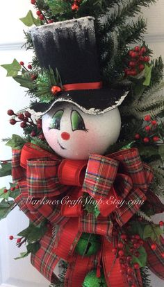 Here comes Frosty! He has quite a whimsical look about him with his crooked little smile ~~~ he ready for the Holidays! This hand painted Snowman Door sawg is decorated with berries and Plaid ribbon. There are two green jingle bells attached to his colar bow that coordinate with the reds and greens. The brim of his hat is dusted with a sparkly snowy finish. The measurements are about 34 inches long and 16 inches wide. This is a READY MADE ITEM ~~~~ READY TO SHIP!!!  Thanks for looking and…