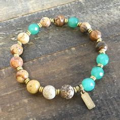 Beautiful bracelet made with picture jasper and green aventurine gemstones with African trade beads, stringed on our signature thick hitec elastic for comfort. An earthy, interesting combination of co