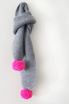 Grey scarf with pink pom poms