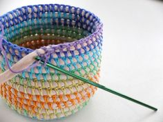 "hatandsandalsguy: ""podkins: "" COIL + CROCHET RAINBOW BASKET DIY Oooo I love this. I've been making some of these for myself, but this is a very helpful tutorial that I hadn't seen before. Crochet Storage Basket Pattern Lots Of Ideas An old t-shirt Crochet Diy, Crochet Home, Crochet Crafts, Yarn Crafts, Sewing Crafts, Crochet Ideas, Plastic Bag Crafts, Recycled Plastic Bags, Recycled Magazines"