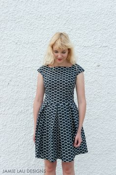 Image of Navy Pleated Tonbo Dress