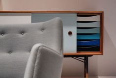 The Sideboard with coloured sliding doors and trays designed by Finn Juhl for BOVIRKE in 1955 at OneCollection.jpg 620×420 pixels