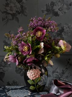 So rich and lovely....Deep purple Anemones and French Lilacs and the gorgeous vase.